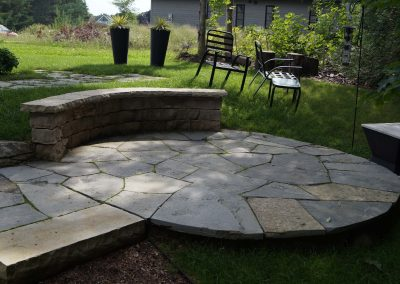 Flagstone patio and curved wall