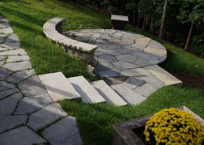 Flagstone patio, steps and curved seat wall