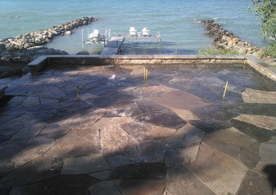Flagstone patio and stone wall