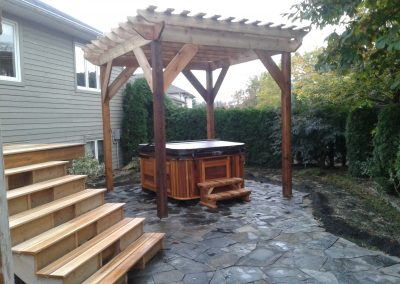 Flagstone patio with cedar pergola and deck
