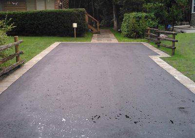 Soldier course on asphalt driveway