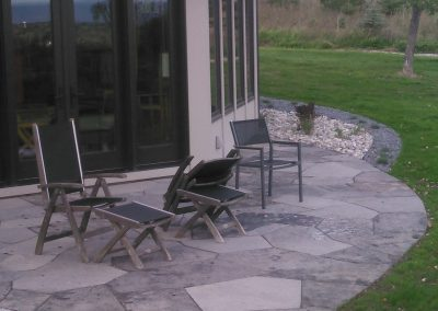 Jumbo flagstone patio and gravel mulched gardens